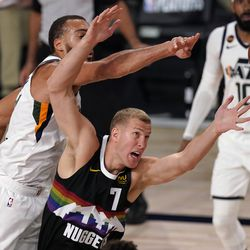 Utah Jazz's Rudy Gobert, left, and Denver Nuggets' Mason Plumlee (7) compete for control of the ball during the second half an NBA first round playoff basketball game, Tuesday, Sept. 1, 2020, in Lake Buena Vista, Fla.