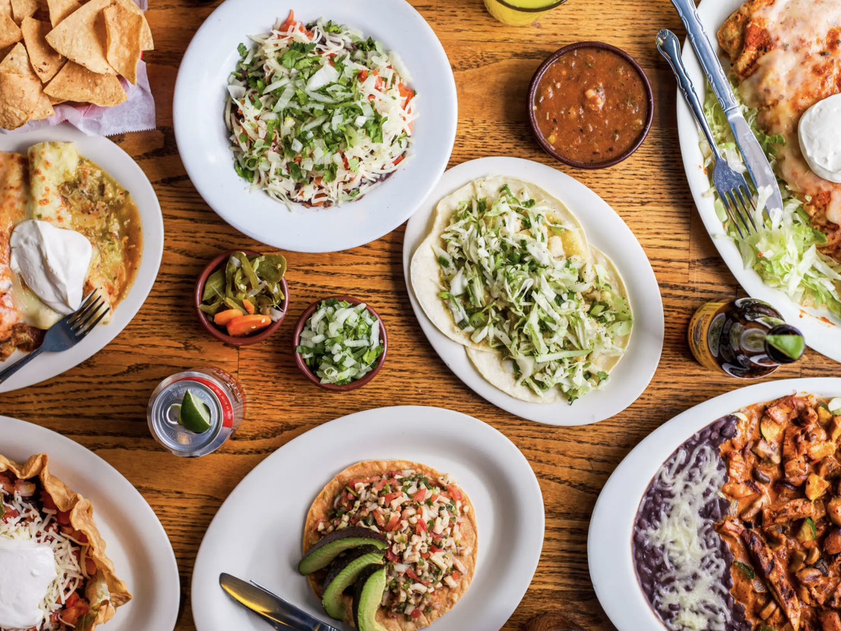 A selection of burritos, tacos, and other Mexican plates at Gorditos in Seattle, top-down view