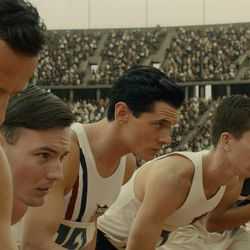 """Jack O'Connell stars as Olympian and war hero Louis """"Louie"""" Zamperini in """"Unbroken,"""" an epic drama that follows the incredible life of Zamperini who, along with two other crewmen, survived in a raft for 47 days after a near-fatal plane crash in WWII — only to be caught by the Japanese Navy and sent to a prisoner-of-war camp."""