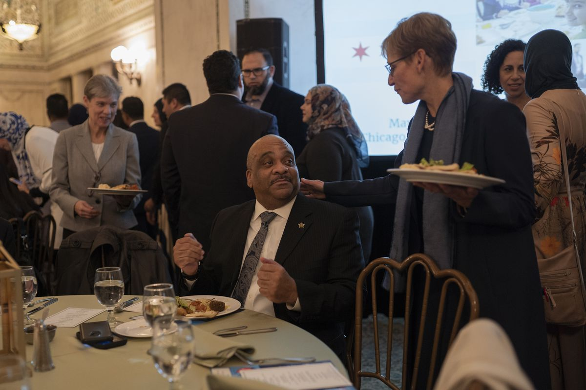 Chicago Police Supt. Eddie Johnson speaks to Amy Rule, Mayor Rahm Emanuel's wife, during the annual iftar meal at the Chicago Cultural Center on May 7, 2019.   Pat Nabong/For The Sun-Times
