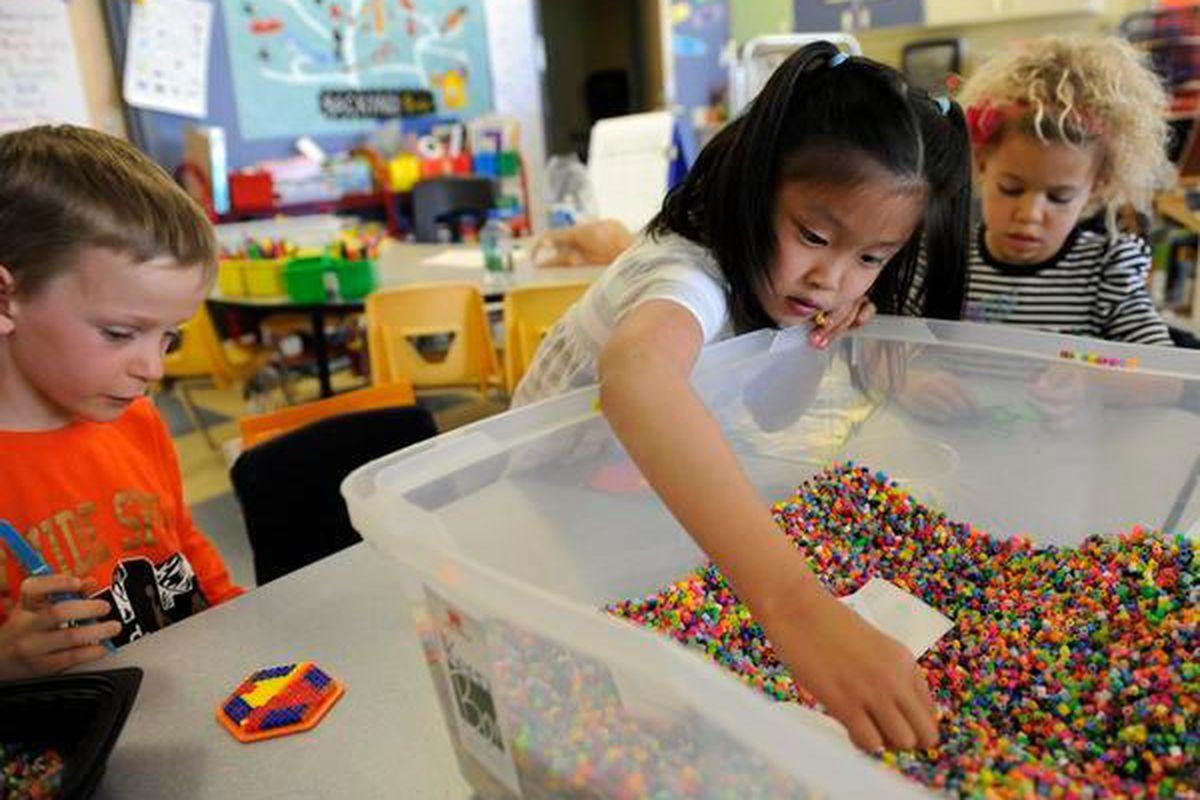 Kindergarten students in Stapleton count beads in 2011.