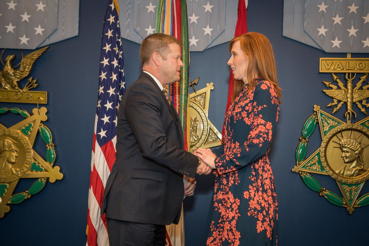 Secretary of the Army Ryan D. McCarthy greets Jennie Taylor of Utah as McCarthy hosts a Civilian Aide to the Secretary of the Army Investiture Ceremony in the Hall of Heroes at the Pentagon in Arlington, Va., Jan. 14, 2020.