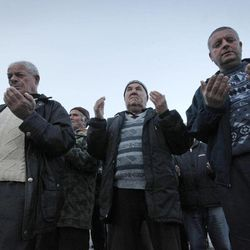 In this Wednesday March 28, 2012 photo Bulgarian Muslims pray during a commemoration ceremony for the victims of the communist repression,  39 years ago, Kornitsa, Bulgaria. On March 28, 1973 police and army units stormed the village of Kornitsa and opened fire on hundreds at people gathered in the square to protest the communist regime's campaign to force Bulgaria's Muslims to adopt non-Islamic names and break up their communities. The brutal crackdown left five men dead and more than 100 wounded. More than 70 families were forced to leave their homes and settle in remote villages.