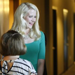 Elizabeth Smart talks with attendees prior to speaking during Fight Like Girls intro night at in Salt Lake City Thursday, June 23, 2016.