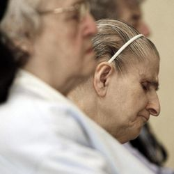 In this April 10, 2012, photo, sister Theresa LaBrecque, center, prays during Mass at St. Joseph Convent in Biddeford, Maine. Good Shepherd Sisters of Quebec has just six convents in Maine and Massachusetts with fewer than 60 sisters. The youngest is 64, and it's been more than 20 years since a new member has joined. Sister Elaine Lachance is using the Internet, social media and even a blog to attract women who feel the calling to serve God.
