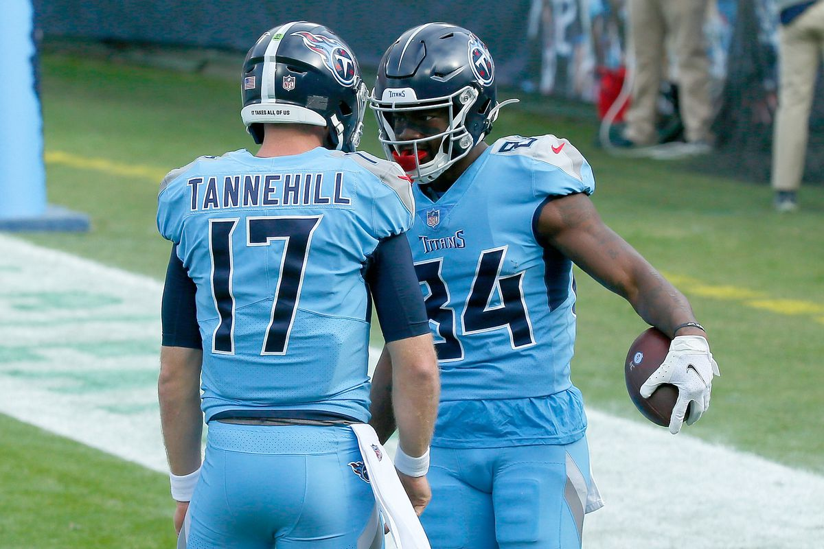 Quarterback Ryan Tannehill of the Tennessee Titans celebrates with wide receiver Corey Davis #84 after his touchdown catch against the Cleveland Browns in the second quarter at Nissan Stadium on December 06, 2020 in Nashville, Tennessee.