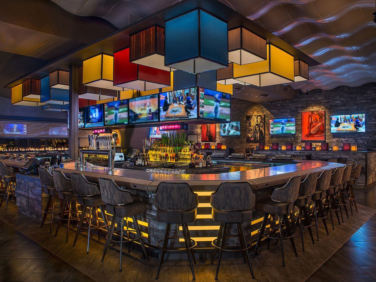 A bar interior with red, blue, and yellow lights
