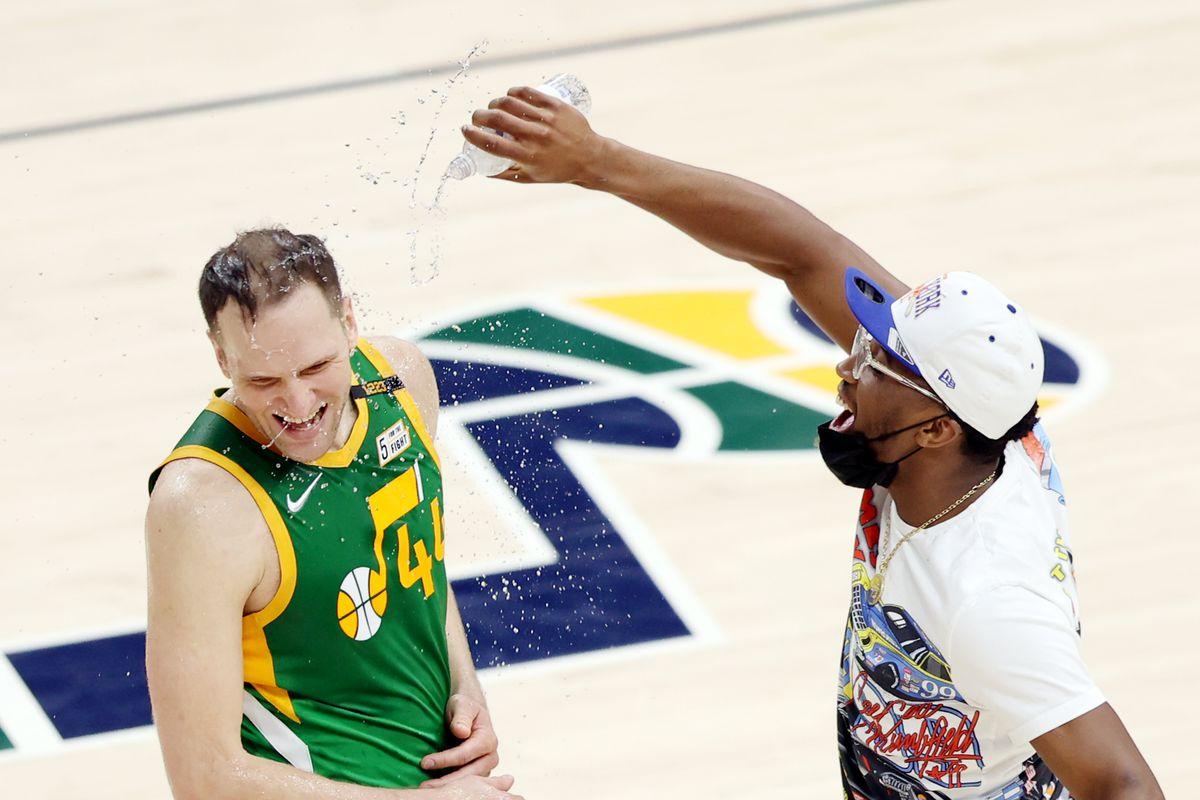 Utah Jazz forward Bojan Bogdanovic (44) is hit with water from Utah Jazz guard Donovan Mitchell (45) as Utah Jazz defeat the Denver Nuggets in an NBA basketball game at Vivint Arena in Salt Lake City on Friday, May 7, 2021. Utah won 127-120.