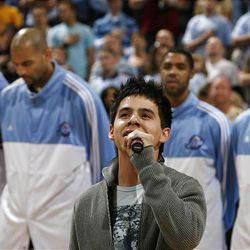 """David Archuleta sings the national anthem before the Utah Jazz's NBA playoff game in Salt Lake City Friday. Archuleta is one of three remaining finalists on """"American Idol."""""""