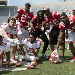 Badgers from both sides of the ball gather for another pose