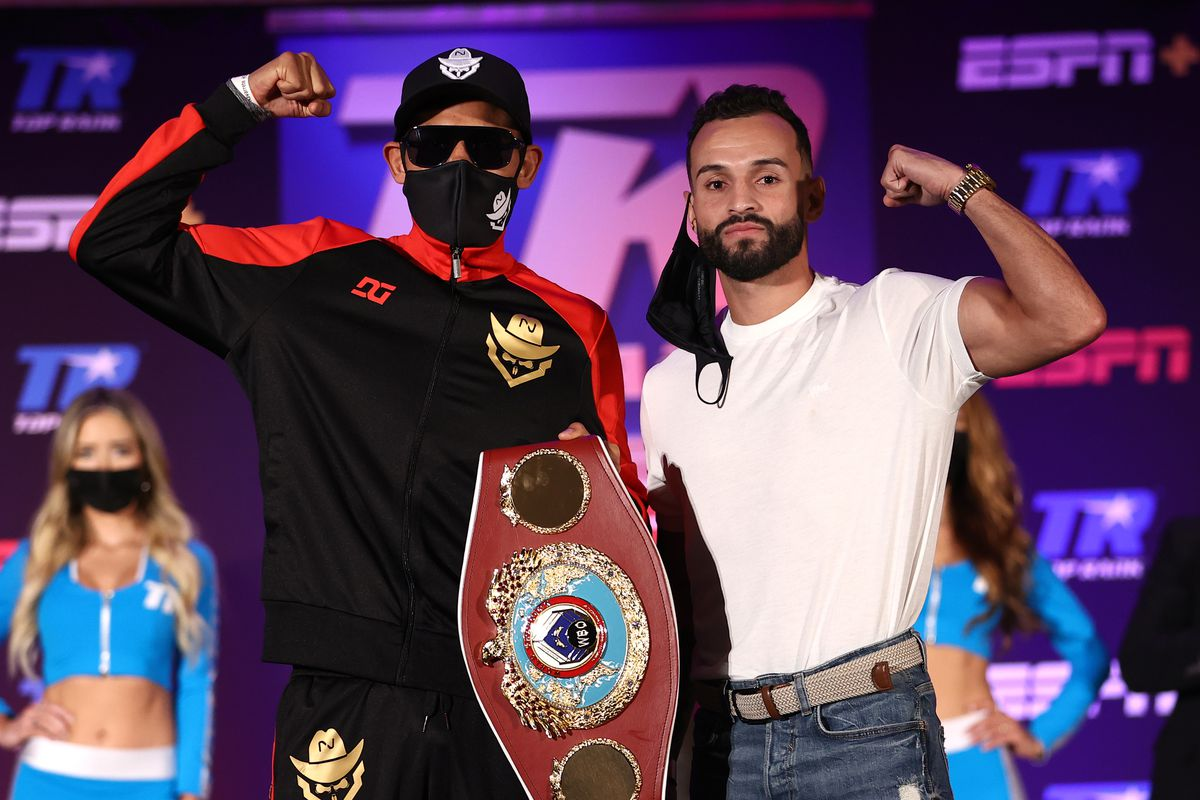 Emanuel Navarrete and Christopher Diaz pose during their press conference for the WBO featherweight title at the Silver Spurs Arena on April 22, 2021 in Kissimmee, Florida.