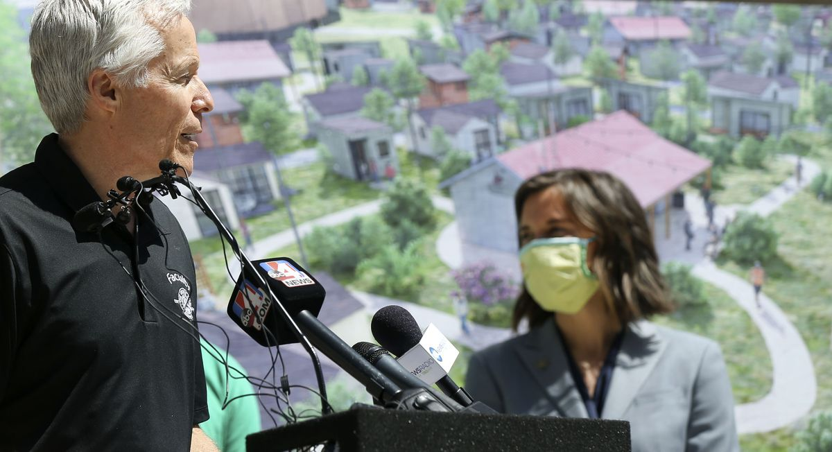 Joseph Grenny, chairman of The Other Side Academy, left, discusses a partnership with Salt Lake City to create The Other Side Village — a tiny home community to serve people experiencing chronic homelessness — during a press conference at the City-County Building on Thursday, April 28, 2021. At right is Mayor Erin Mendenhall.