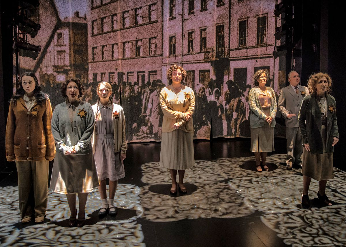 """The cast of the Chicago Shakespeare Theater production of """"The Book of Joseph,"""" seen against archival footage from occupied Poland in World War II. (Photo: Liz Lauren)"""