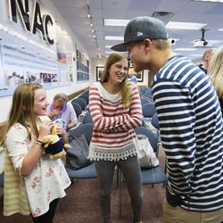 Eliza O'Neil, 10, left, her sister Kira, 13, center, and their cousin, Jeremy Reynolds, right, share a laugh as CEO of the Philadelphia 76ers Scott O'Neil visits students of the BYU Marriott School in Provo, Thursday, Oct. 13, 2016.