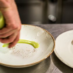 Green onion sauce (green onions, white wine, honey) is added to the plate.