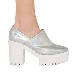 """Pixie Market Holographic Platform Shoes, <a href=""""http://www.pixiemarket.com/holographic-platform-shoes-18827.html """">$128</a>. Because this roundup wouldn't be complete without a pair of moon boots."""