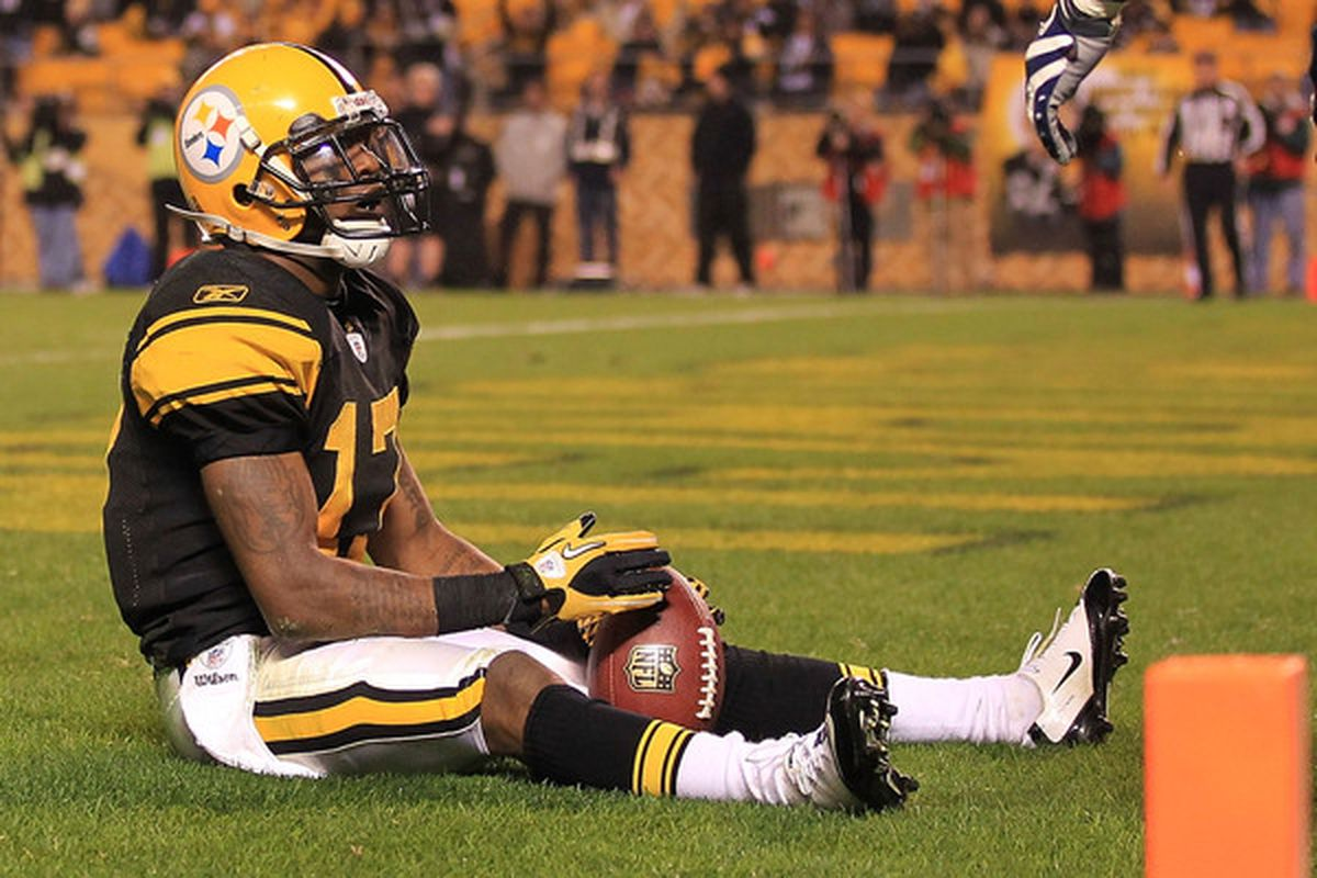 PITTSBURGH - NOVEMBER 14:  Mike Wallace #17 of the Pittsburgh Steelers celebrates scoring a touchdown against the New England Patriots on November 14 2010 at Heinz Field in Pittsburgh Pennsylvania.  (Photo by Chris McGrath/Getty Images)