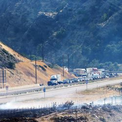 Traffic is stoped westbound on I-84 as fire burns homes and property Tuesday, Sept. 5, 2017.