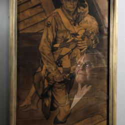 """Mary Immen Hall of Bennington, Vt., is reflected in the 1940 Norman Rockwell illustration """"A Scout is Helpful"""" for which she modeled at the Bennington Museum on Friday, Sept. 28, 2012, in Bennington, Vt."""