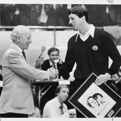 BYU Quarterbacks online photo gallery: Deseret News publisher Wendell Ashton presents BYU quarterback Marc Wilson with the Deseret News Athlete of the Year Award at halftime of a BYU-Wyoming basketball game on Jan. 19, 1980. Wilson received a five-minute standing ovation from the crowd of 22,218.