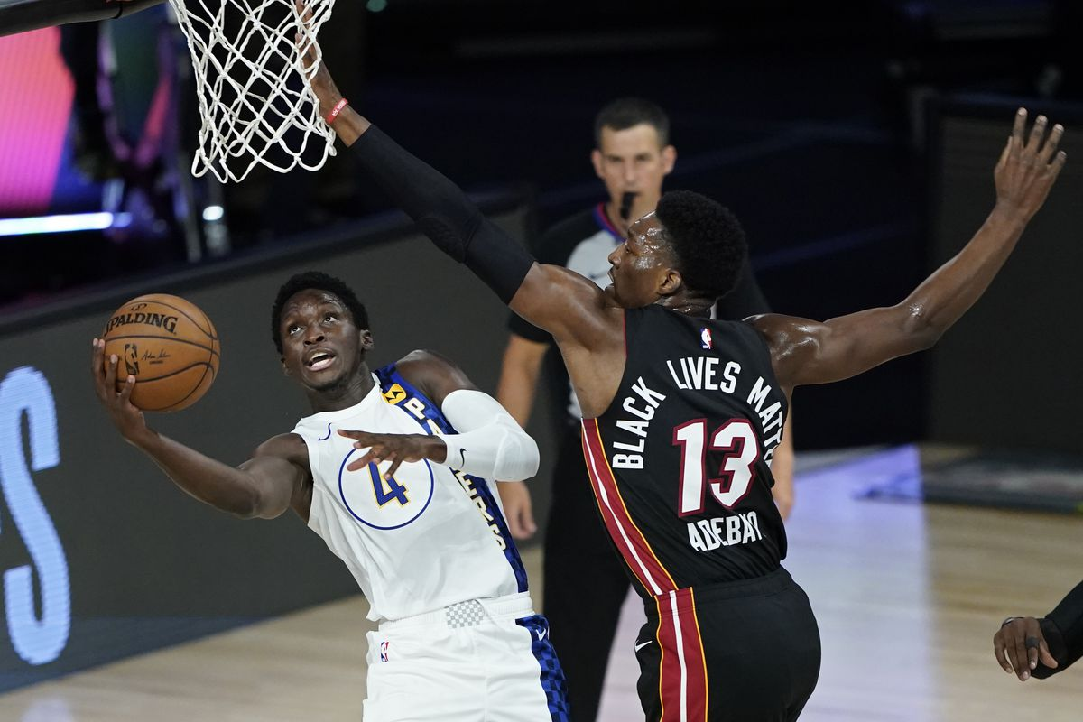 Victor Oladipo of the Indiana Pacers shoots around Bam Adebayo of the Miami Heat during the first half of a first round playoff game at The Field House at ESPN Wide World Of Sports Complex on August 24, 2020 in Lake Buena Vista, Florida.