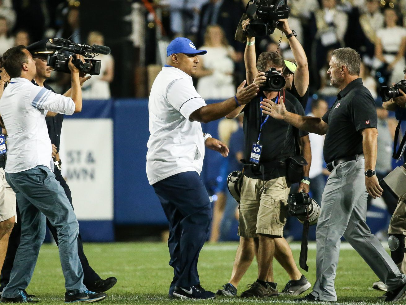 BYU coach Kalani Sitake, left, and Utah coach Kyle Whittingham shake hands after game at LaVell Edwards Stadium in Provo on Saturday, Sept. 9, 2017.