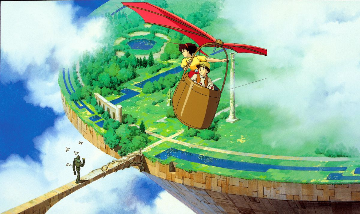 The child protagonists of Castle in the Sky fly in a kite-like contraption above the green fields of Laputa, while a robot surrounded by birds walks below.