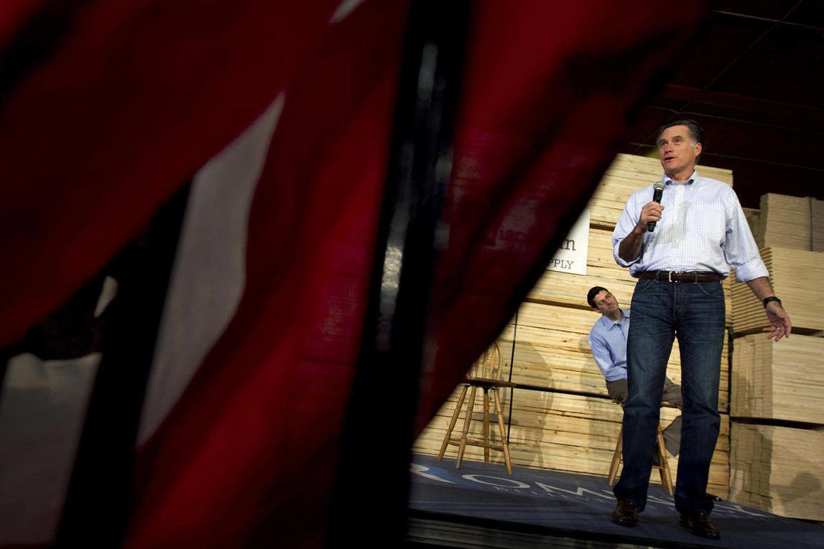 Republican presidential candidate, former Massachusetts Gov. Mitt Romney, accompanied by House Budget Committee Chairman Rep. Paul Ryan, R-Wis., speaks at a building supply store in Green Bay, Wis., Monday, April 2, 2012.