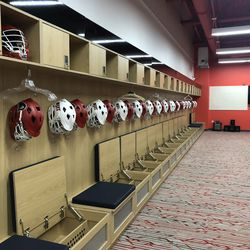 NJIT's locker room is nearby the athletic fitness center. There are 45 total individual stalls with hooks, a cubby, a padded seat with storage underneath, a personal safe, and their name plate. Another shelf is expected for next season.