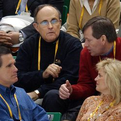 Former New York City Mayor Rudolph Gulliani, left, sits with Utah Gov. Mike Leavitt, right, SLOC president Mitt Romney, bottom left, and his wife, Ann Romney, between races at the Short Track competition Saturday, Feb. 23, 2002 at the Salt Lake Ice Center.