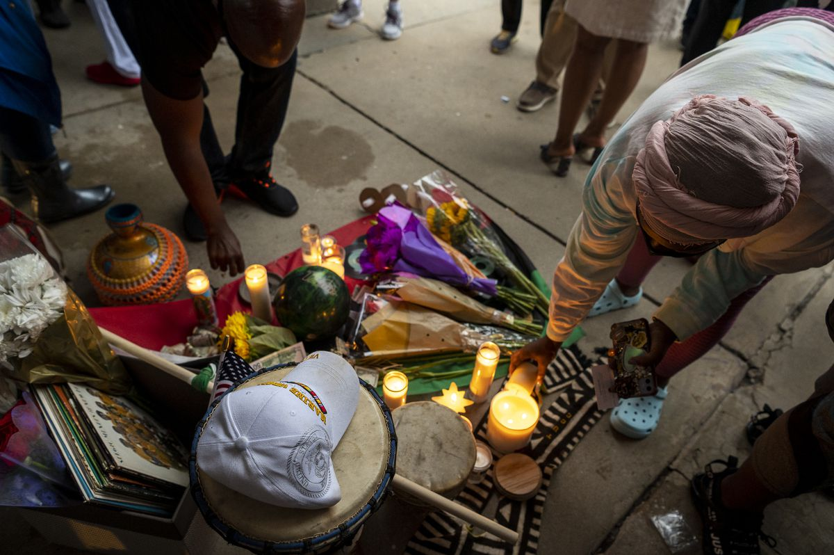 A memorial was set up Friday, July 16, 2021 at Kimbark Plaza for Keith Cooper, who died after he was punched in the head during an attempted carjacking in the plaza earlier in the week.