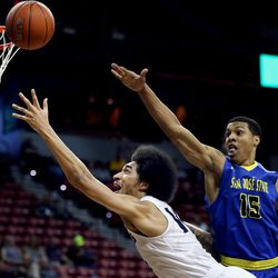 Utah State Aggies Jalen Moore drives against San Jose State Spartans' Brandon Clarke at the Mountain West Men's Basketball Championships at the Thomas & Mack Center, Las Vegas, Nevada on Wednesday, March 8, 2017.