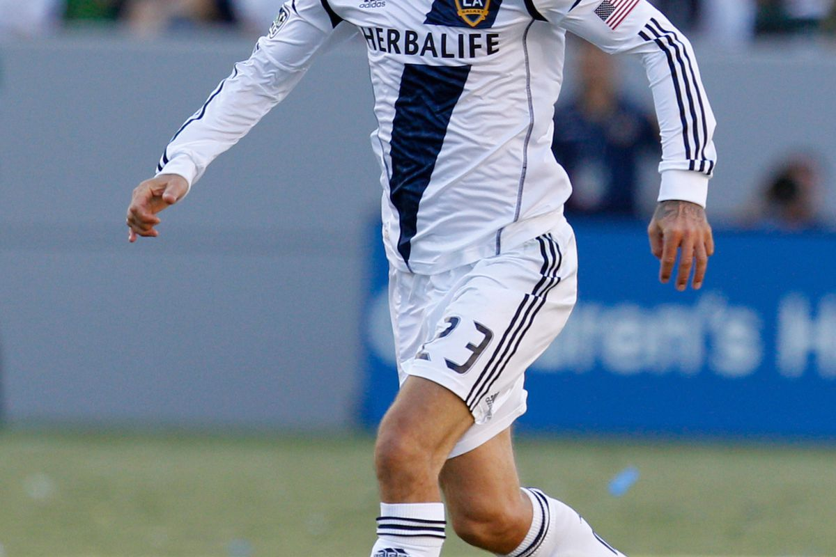CARSON, CA - AUGUST 26: David Beckham #23 of Los Angeles Galaxy dribbles the ball during the MLS match against FC Dallas at The Home Depot Center on August 26, 2012 in Carson, California. The Galaxy won 2-0. (Photo by Ric Tapia/Getty Images)
