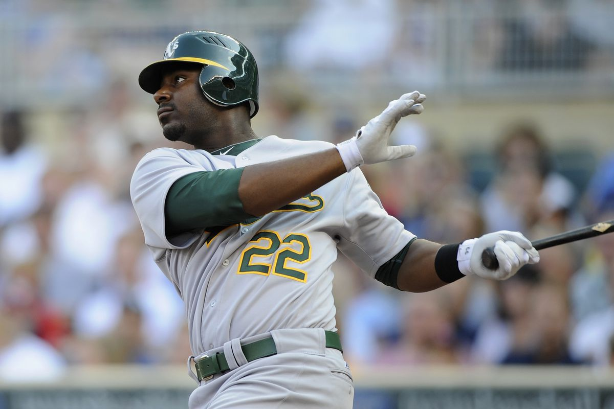 MINNEAPOLIS, MN:: Chris Carter #22 of the Oakland Athletics hits a three run home run against the Minnesota Twins during the first inning at Target Field in Minneapolis, Minnesota. (Photo by Hannah Foslien/Getty Images)