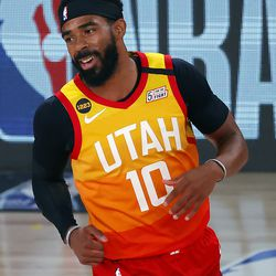 Utah Jazz' Mike Conley celebrates a three-point basket against the Denver Nuggets during the first quarter of an NBA basketball game Saturday, Aug. 8, 2020, in Lake Buena Vista, Fla.