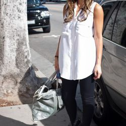 """<a href=""""http://la.racked.com/archives/2011/03/02/eva_at_la_cienega_and_melrose.php"""" rel=""""nofollow"""">Eva</a>'s blouse is from Rag & Bone, her pants are by J Brand, her shoes are Derek Lam, and her sunglasses are by Tom Ford. <br /><br />Photo by <a hre"""