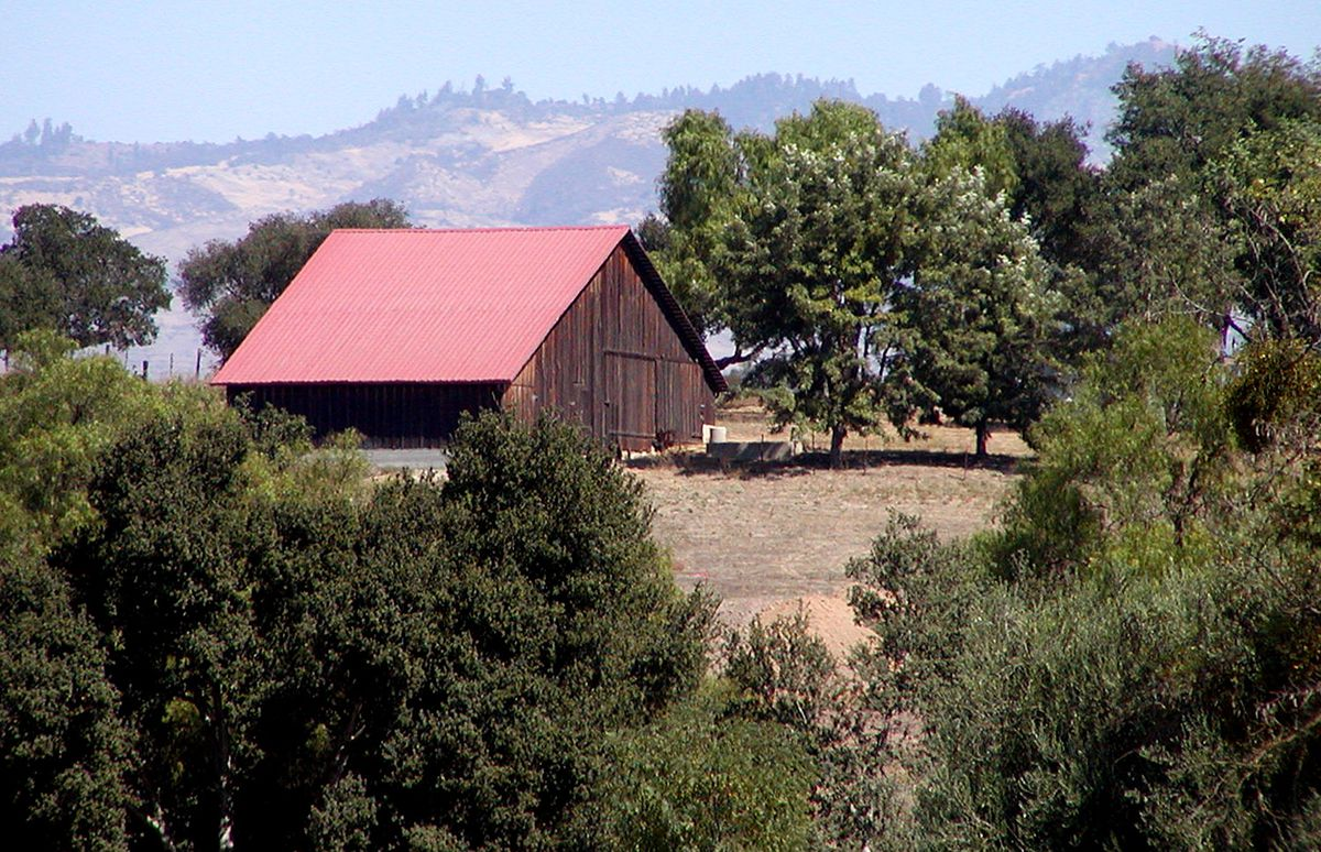 A wooden barn with red roof on the Central Coast.
