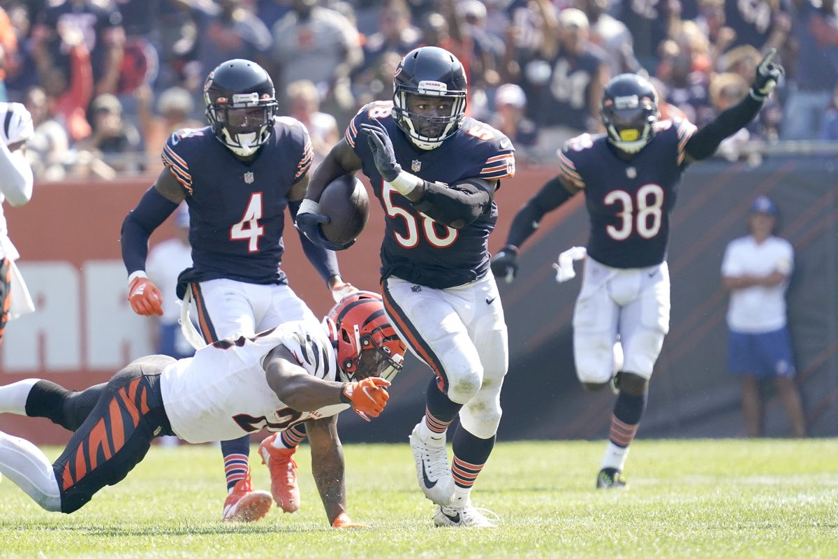 Bears linebacker Roquan Smith (58) motors into the end zone as teammate Tashaun Gipson (38) celebrates to complete a 53-yard interception return of a Joe Burrow pass in the Bears' 20-17 victory over the Bengals on Sunday at Soldier Field.
