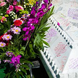 Friends and family wrote messages on the coffin's vault at Kennedy Hansen's funeral in Ogden, Thursday, June 5, 2014.