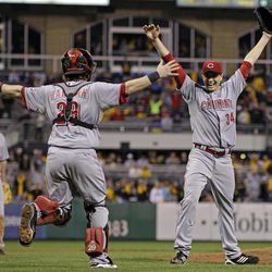 Cincinnati Reds starting pitcher Homer Bailey (34) celebrates with Cincinnati Reds catcher Ryan Hanigan (29) after getting the final out of a no-hitter in a baseball game against the Pittsburgh Pirates in Pittsburgh Friday, Sept. 28, 2012. The Reds won 1-0.