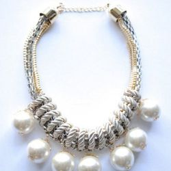 """<a href=""""http://www.shopvonz.com/collections/necklaces/products/pearl-necklace"""">Oversize Pearl Necklace</a>, $32"""