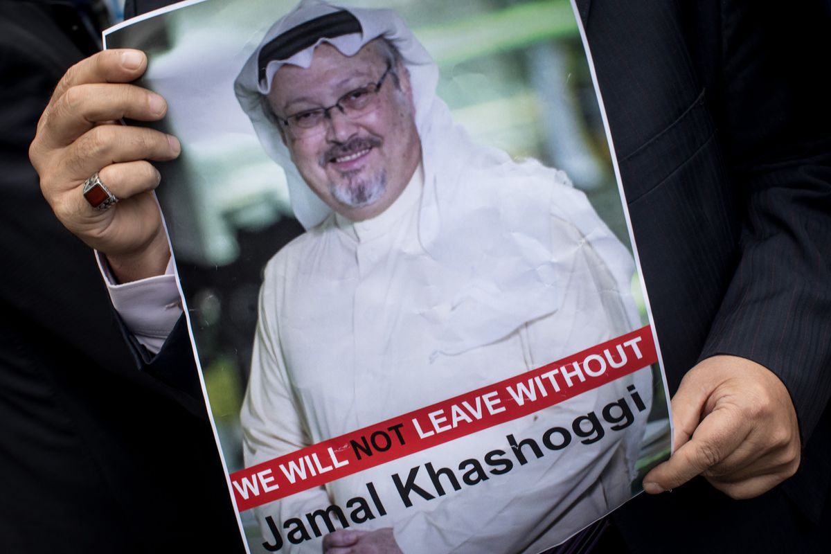 A man holds a poster of slain Saudi journalist Jamal Khashoggi during a protest in Istanbul, Turkey in October 2018.