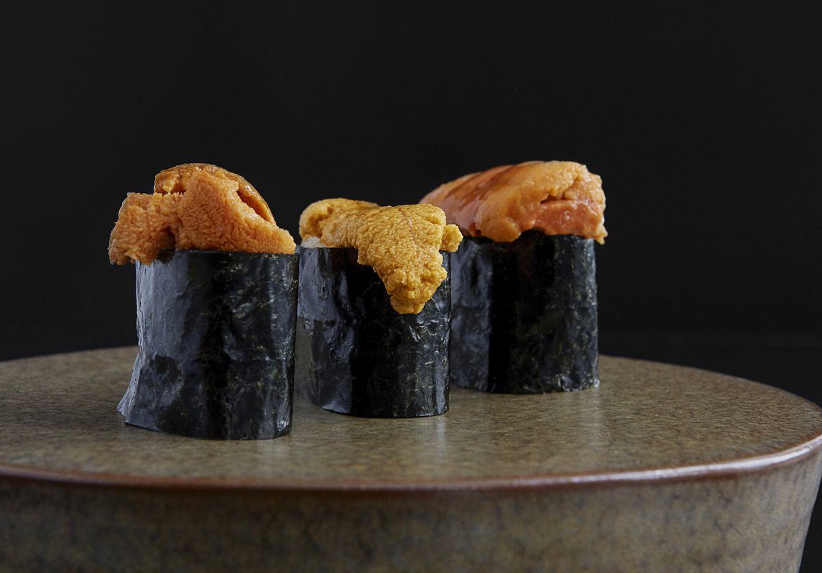 Pieces of black nori wrapped around chunks of orange uni fish
