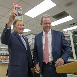 Gov. Gary Herbert holds up a rewards card given to him by Timothy Griffith, president of Speedway LLC, at the opening of a Speedway convenience store and gas station on Beck Street in Salt Lake City on Monday, Nov. 25, 2019. Speedway gas stations will now sell lower-sulfur Tier 3 gasoline. The fuel, brought to Utah by Marathon Petroleum, will not cost any additional money for motorists, yet its pollution reduction in emissions is the equivalent of taking four or five cars off the road.