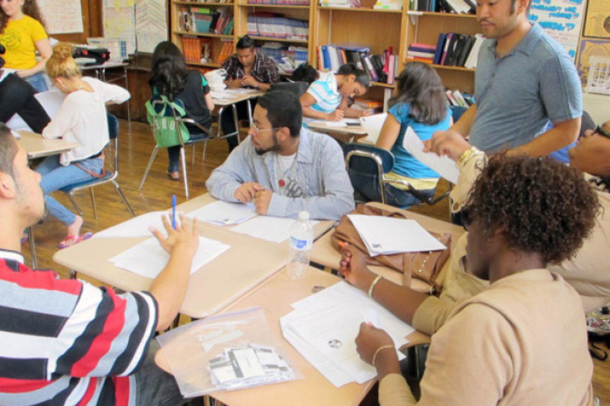 A social studies class at New Design High School, where Scott Conti is principal