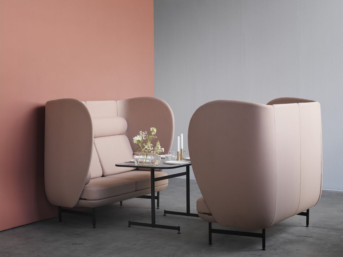 Pink chairs seated around table