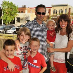 Brooke Romney, right, poses with her husband and four sons.