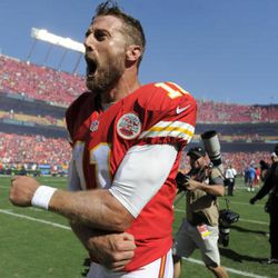 Kansas City Chiefs quarterback Alex Smith (11) celebrates after he scored the winning touchdown against the San Diego Chargers in overtime in an NFL football game in Kansas City, Mo., Sunday, Sept. 11, 2016. The Kansas City Chiefs won 33-27. (AP Photo/Ed Zurga)