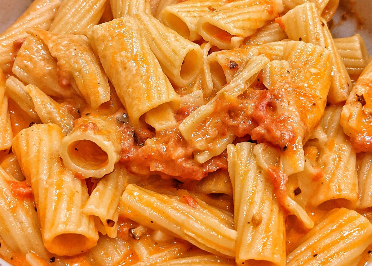A close-up photo of rigatoni noodles in red sauce.
