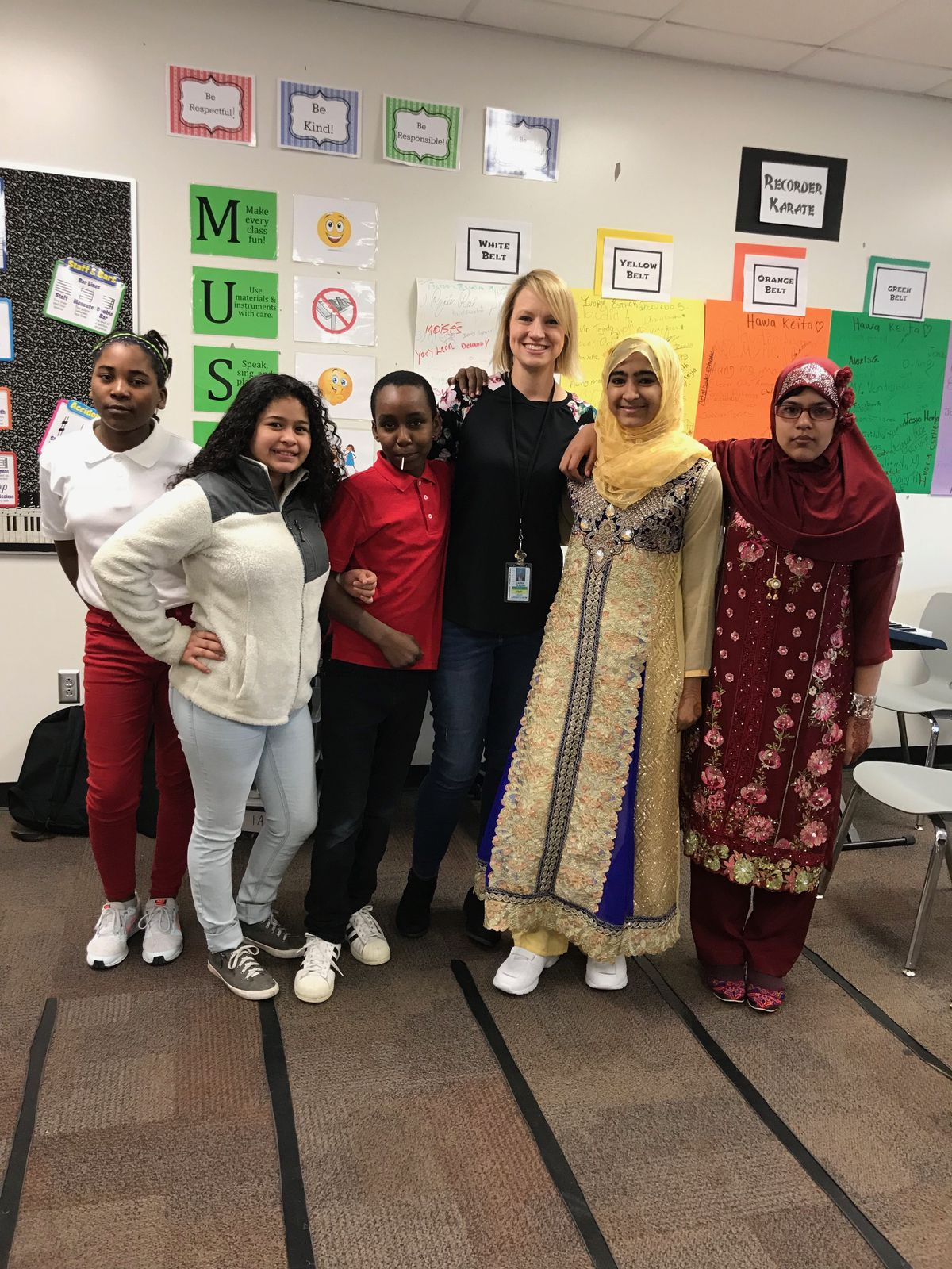 Music teacher Kristin Gladish poses with her students in the Indianapolis Public Schools Newcomer Program.